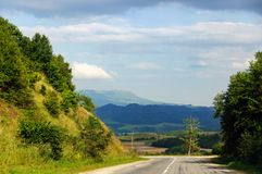 Mountain road. The mountain road, landscape and the blue sky stock photography