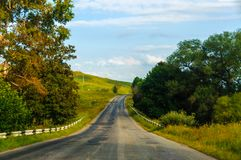 Mountain road. The mountain road, landscape and the blue sky royalty free stock photos