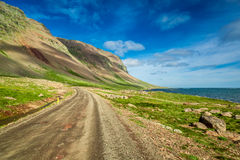 Mountain road near the Arctic sea, Iceland Stock Images