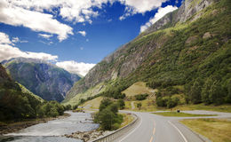 Mountain road in Norway. Scenic empty road and beautiful mountains in Norway Royalty Free Stock Images