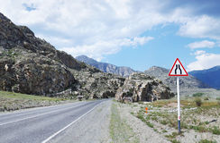 Mountain road passing among rocks Stock Photo