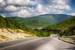 Mountain road, paved road serpentine in the mountains. Mountain landscape. Road, paved road serpentine in the mountains. Mountain landsc stock photos