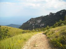 The mountain road and the peaks are beautiful royalty free stock image