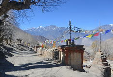 Mountain road with prayer flags. nepal Stock Images