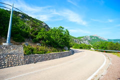 Mountain road , with protection from landslides . Royalty Free Stock Photos