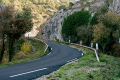 Mountain road in Provence. France. Empty winding mountain road in Provence. France Royalty Free Stock Images