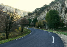 Mountain road in Provence. France. Empty winding mountain road in Provence. France Royalty Free Stock Image