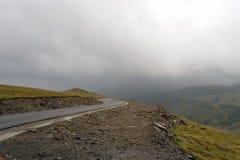 Mountain road, rainy weather Royalty Free Stock Photos