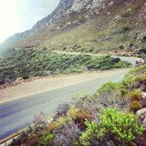 Mountain road. Riding my motorcycle along some mountain roads royalty free stock images
