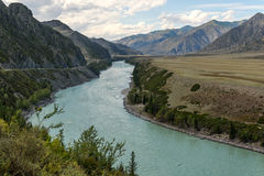 Mountain road river bend Royalty Free Stock Image