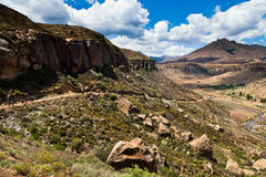 Mountain road and riverbed in the valley Royalty Free Stock Image