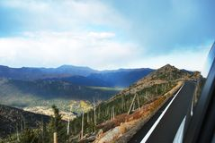 On mountain road at Rocky mountain Stock Images