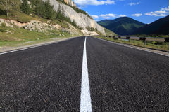 Mountain road in Russian Altai Stock Images