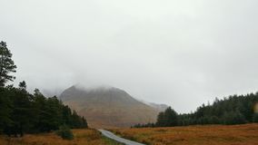 Mountain road in Scotland highland stock video footage