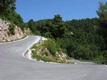 Mountain road with sharp turn Stock Photo