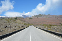 Mountain road on the slope of the volcano Etna Stock Images
