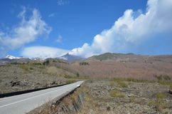 Mountain road on the slope of the volcano Etna Stock Photo