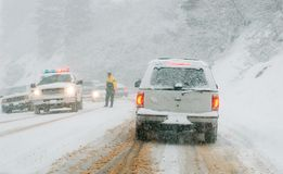 Mountain road in snow storm Royalty Free Stock Photography