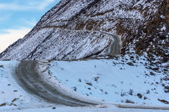 Mountain road snow winter curve Royalty Free Stock Images