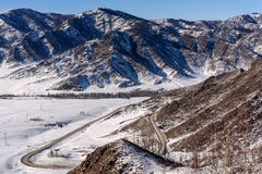 Mountain road snow winter valley Royalty Free Stock Photography