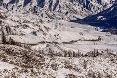 Mountain road snow winter valley Stock Photo