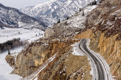 Mountain road snow winter valley Royalty Free Stock Photo