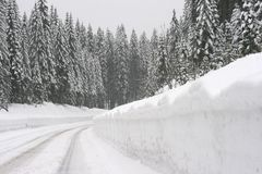 Mountain road in snowstorm Stock Image
