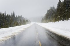 Mountain Road During a Snowstorm Stock Photo