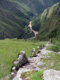 Mountain road stepwise of Machu Picchu. Peru. Urubamba river and valley below Machu Picchu in Peru. Hill with agriculture terraces and mountain roads stepwise Royalty Free Stock Photos