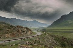 Mountain road before the storm.  Royalty Free Stock Photo