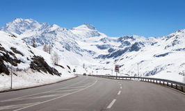 Mountain road. In a sunny day. Simplon Pass, Valais, Switzerland royalty free stock photo