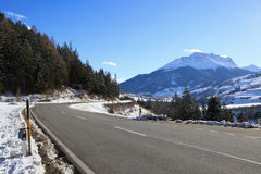 Mountain road in a sunny day Royalty Free Stock Image