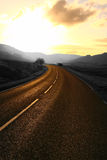 Mountain road at sunrise selective color Royalty Free Stock Photos