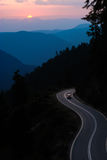 Mountain road at sunset Stock Image