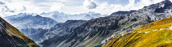 Mountain road in Swiss Alps stock images