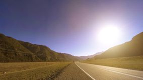 Mountain road timelapse at the summer or autumn sunset sunrise time. Wild nature and rural field. 4K UHD mountain road timelapse at the summer or autumn sunset stock video footage