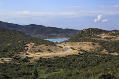 Mountain road to the bay of the Aegean Sea. Stock Photography