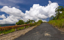 Mountain road to the clouds Royalty Free Stock Image
