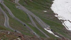 Mountain road to Stelvio pass. Beautiful view of mountain road to Stelvio pass Passo del Stelvio in Italian Alps stock video footage