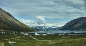A mountain road to the town of Isafjordur and a view of the fjord. Travel to Iceland. A mountain road to the town of Isafjordur and a view of the fjord Royalty Free Stock Photo