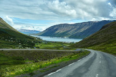 A mountain road to the town of Isafjordur and a view of the fjord. Travel to Iceland. A mountain road to the town of Isafjordur and a view of the fjord Royalty Free Stock Photography