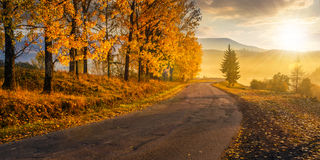 Mountain road to village in mountains Stock Image