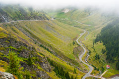 Mountain road Transfegerash. Travel over the mountains of Romania and crossing the translated Fegerasch Royalty Free Stock Photography