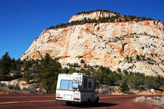 Mountain Road Trip. An RV cruises on a twisty mountain road Stock Images
