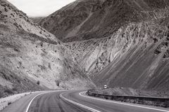 Mountain road trip landscape in black and white stock photography