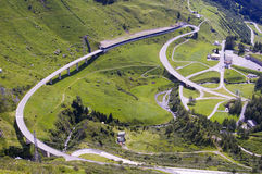 Mountain road and tunnel in italian alps. Transportation infrastructure network Stock Photos