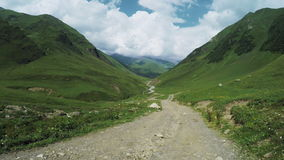 Mountain road turn. Camera moves to steadicam mountain road dating back to turn in Upper Svaneti, Georgia stock footage