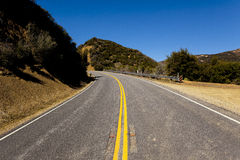 Mountain road turning left uphill Stock Photography