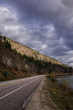 Mountain road under a cloudy sky Royalty Free Stock Photography