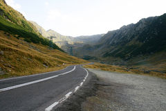 Mountain road through the valley. Going uphill on Transfagarasan road royalty free stock image